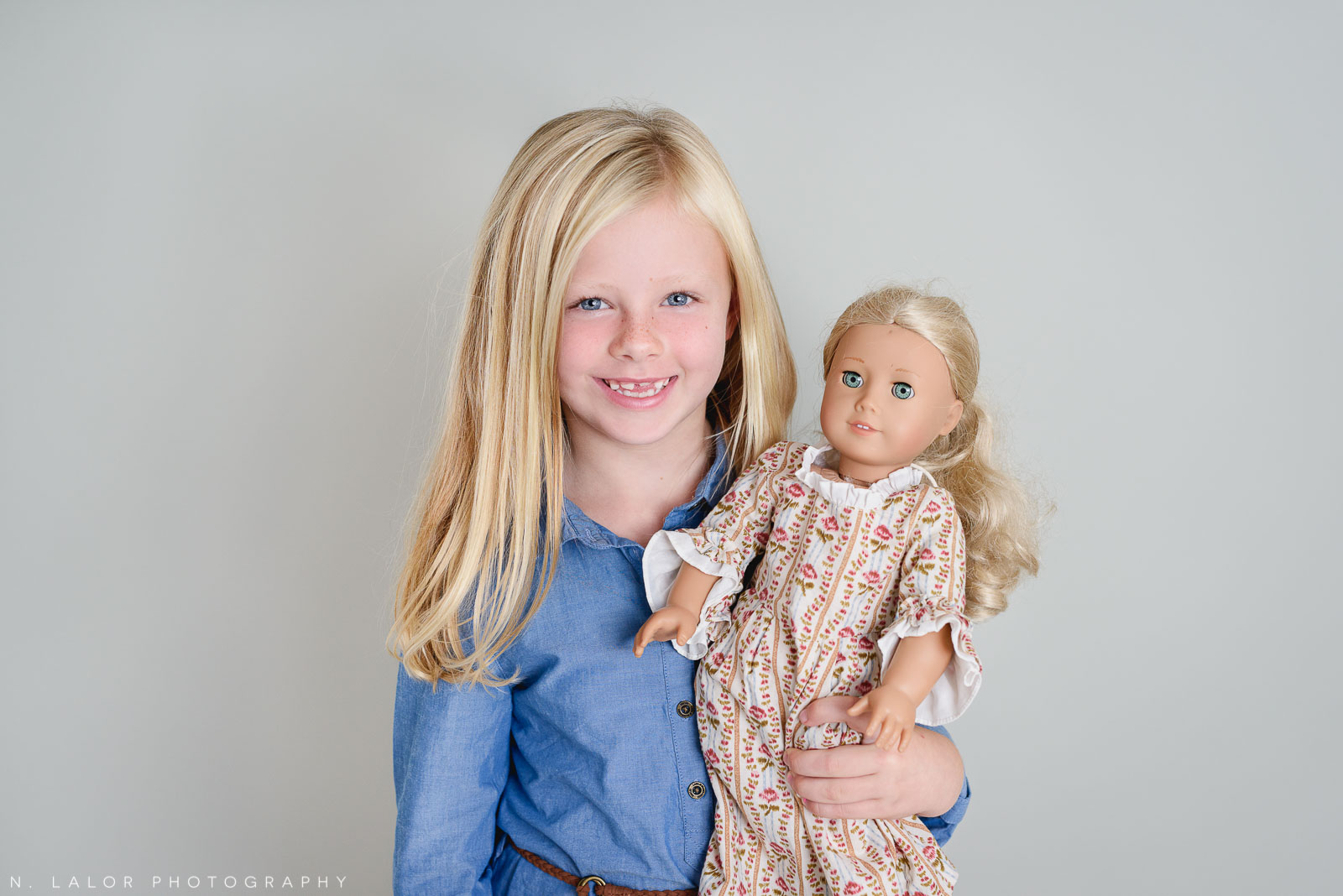 American girl doll love. Studio photoshoot with N. Lalor Photography in Greenwich, Connecticut.