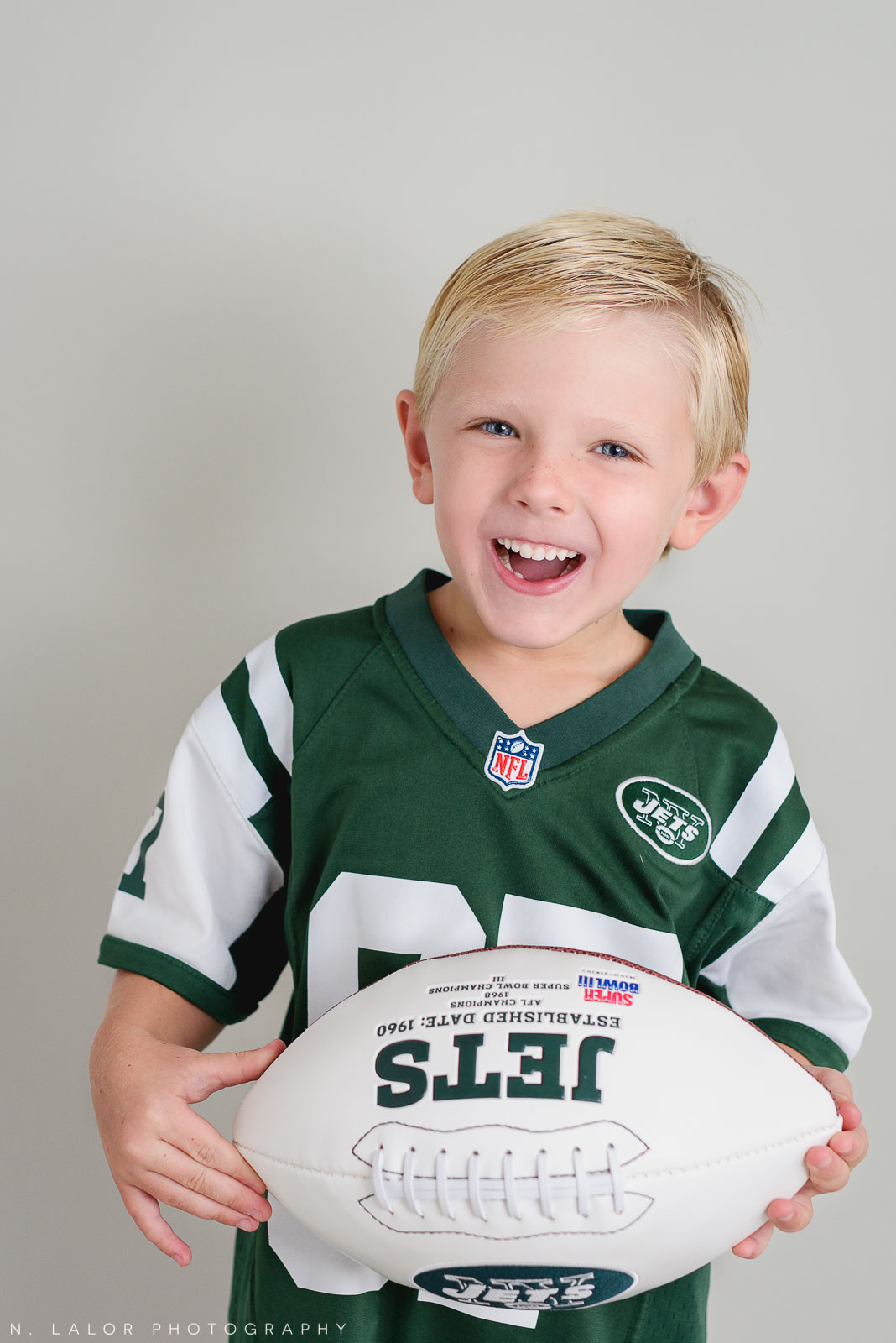 Jets and football. Studio photoshoot with N. Lalor Photography in Greenwich, Connecticut.