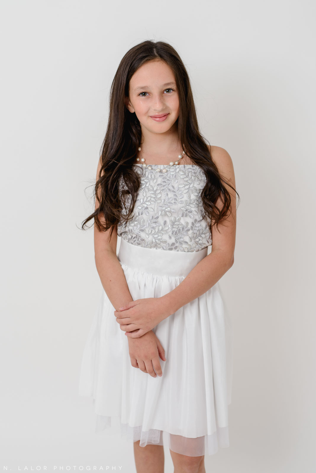 Sparkly white dress. Stella M'Lia tween fashion photoshoot with N. Lalor Photography in Greenwich, Connecticut.