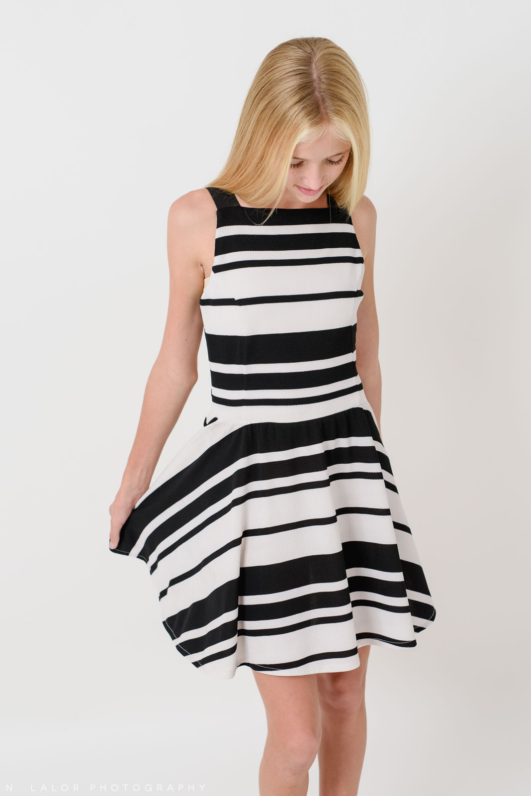 Black and white striped dress. Stella M'Lia tween fashion photoshoot with N. Lalor Photography in Greenwich, Connecticut.