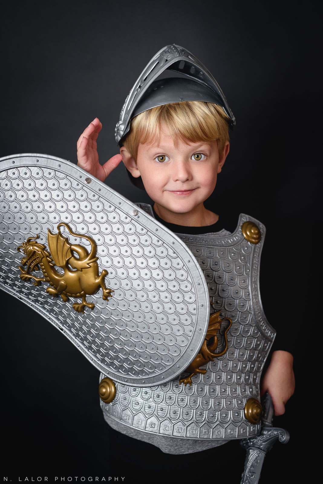 Gallant knight costume. Kids Halloween Portrait by N. Lalor Photography in Greenwich, Connecticut.