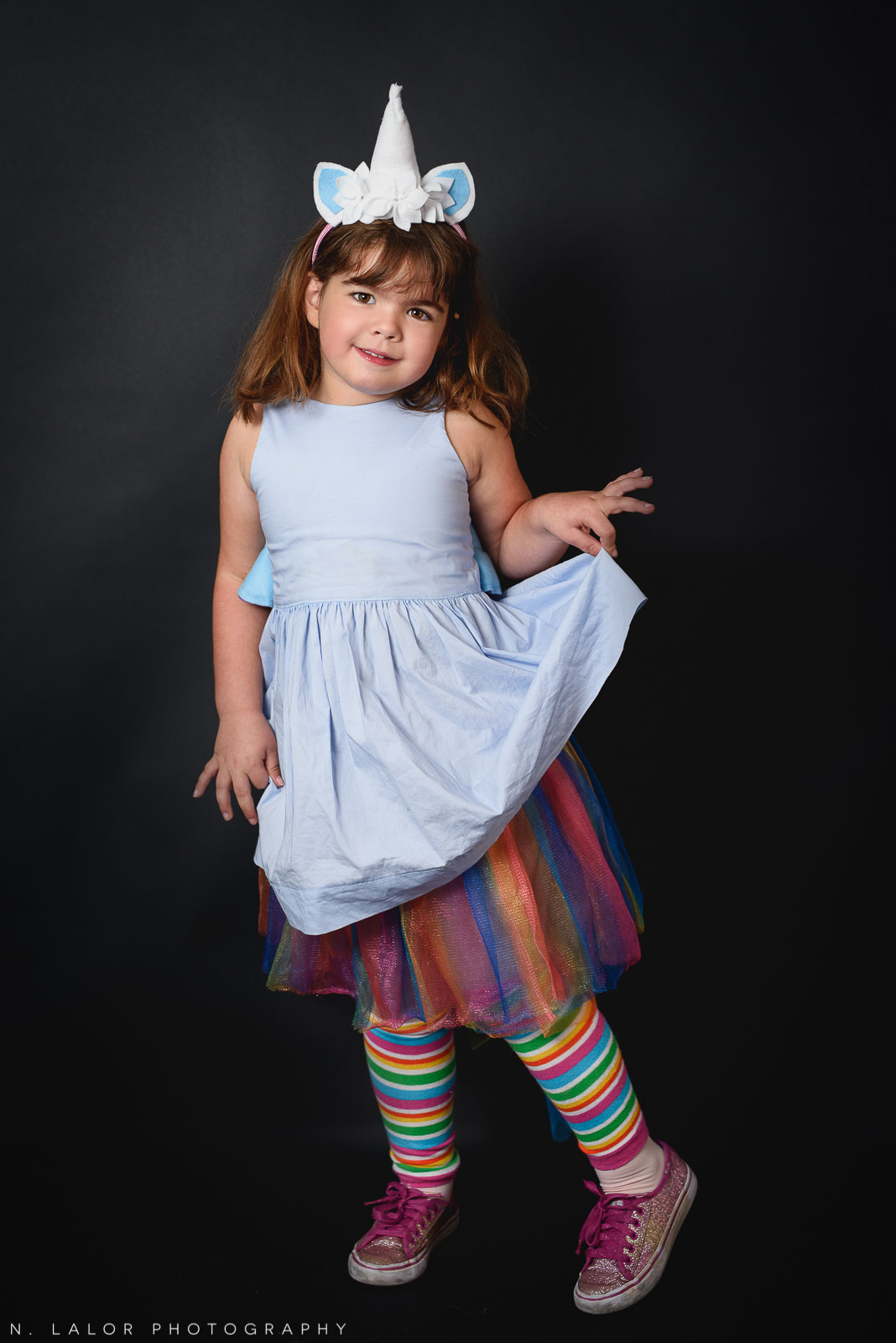 A rainbow unicorn! Kids Halloween Portrait by N. Lalor Photography in Greenwich, Connecticut.