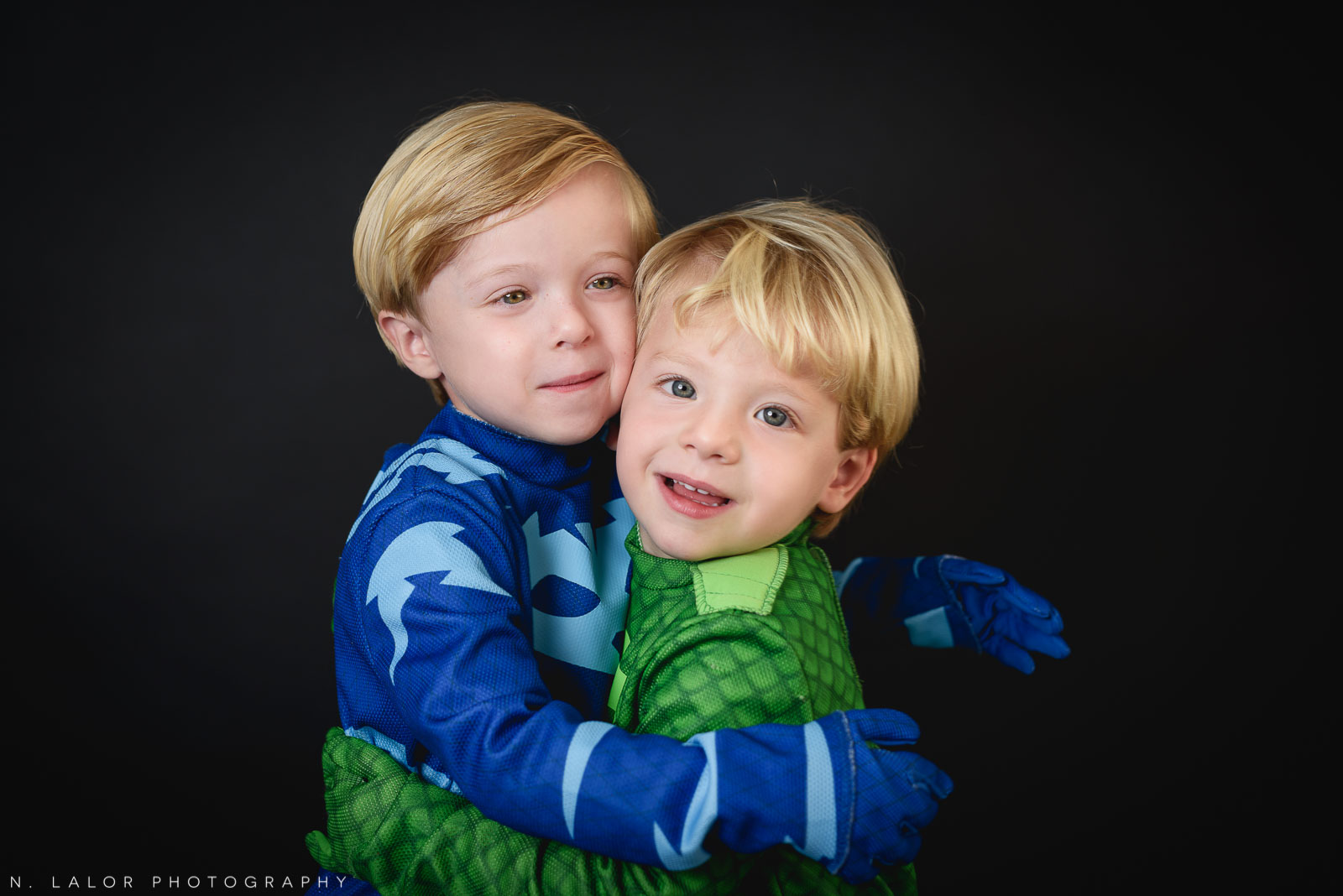PJ Masks brothers. Kids Halloween costume portrait by N. Lalor Photography in Greenwich, Connecticut.