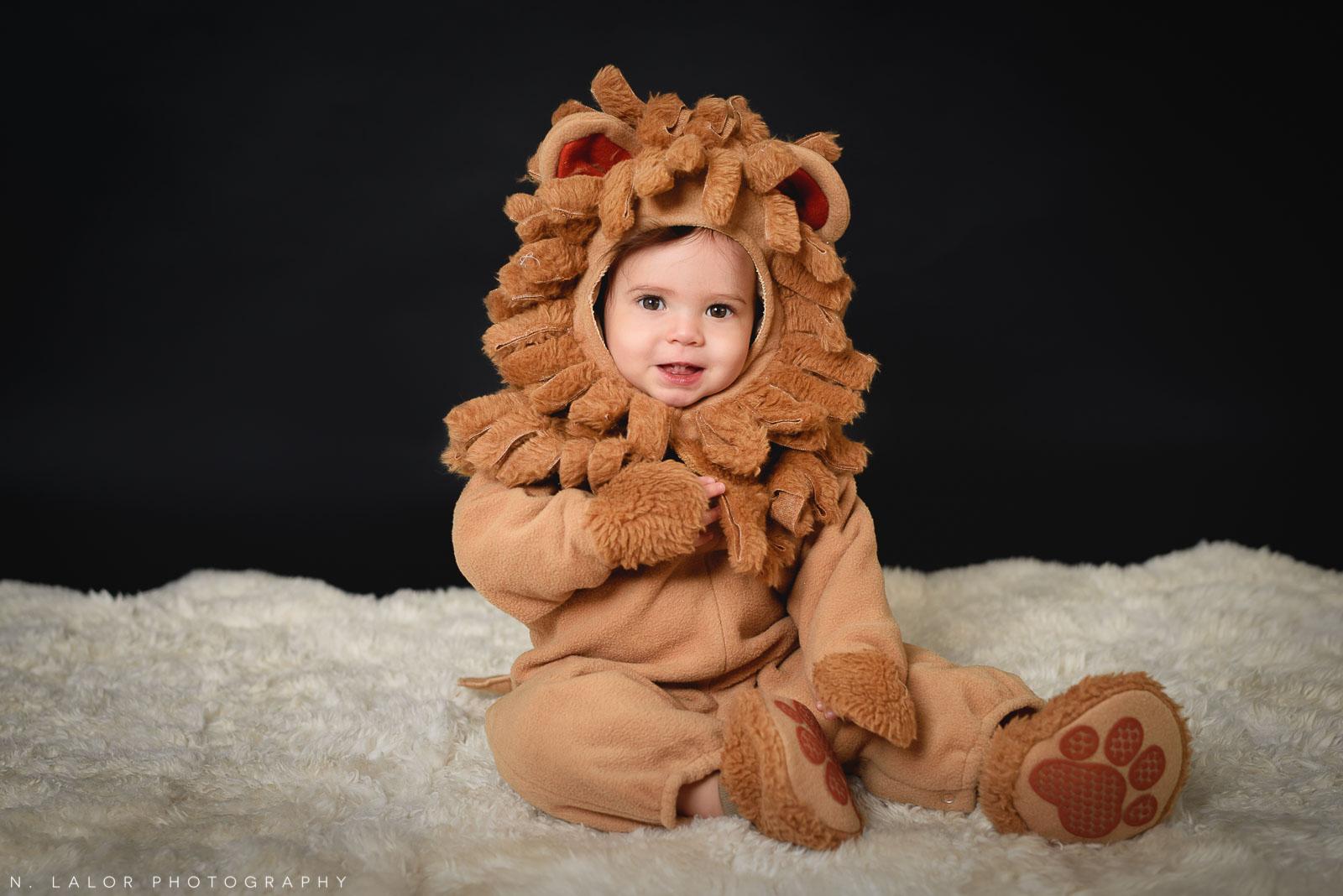 Little lion. PJ Masks. Kids Halloween costume portrait by N. Lalor Photography in Greenwich, Connecticut.