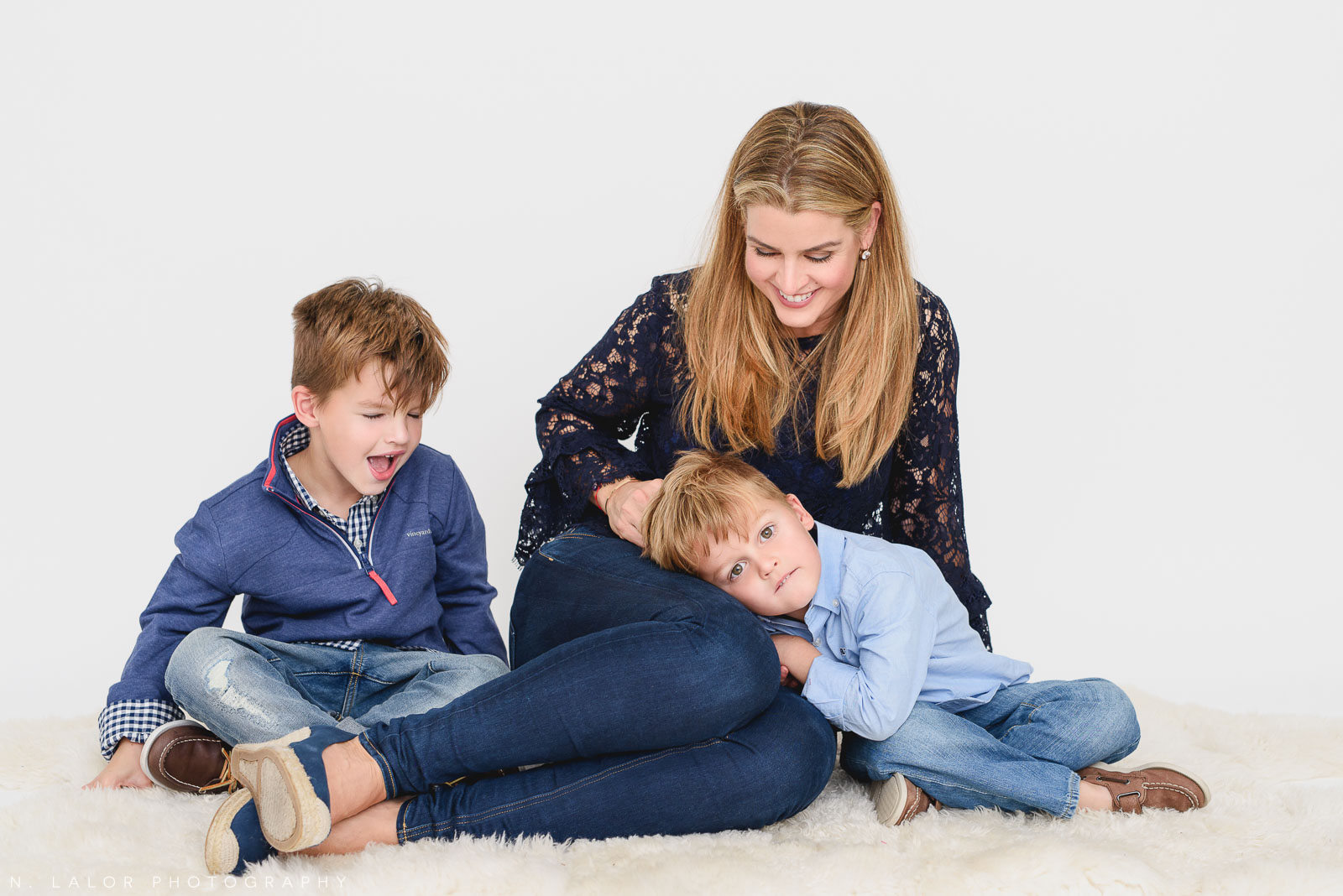 Mom with her two boys. Studio photo session with N. Lalor Photography. Greenwich, Connecticut.