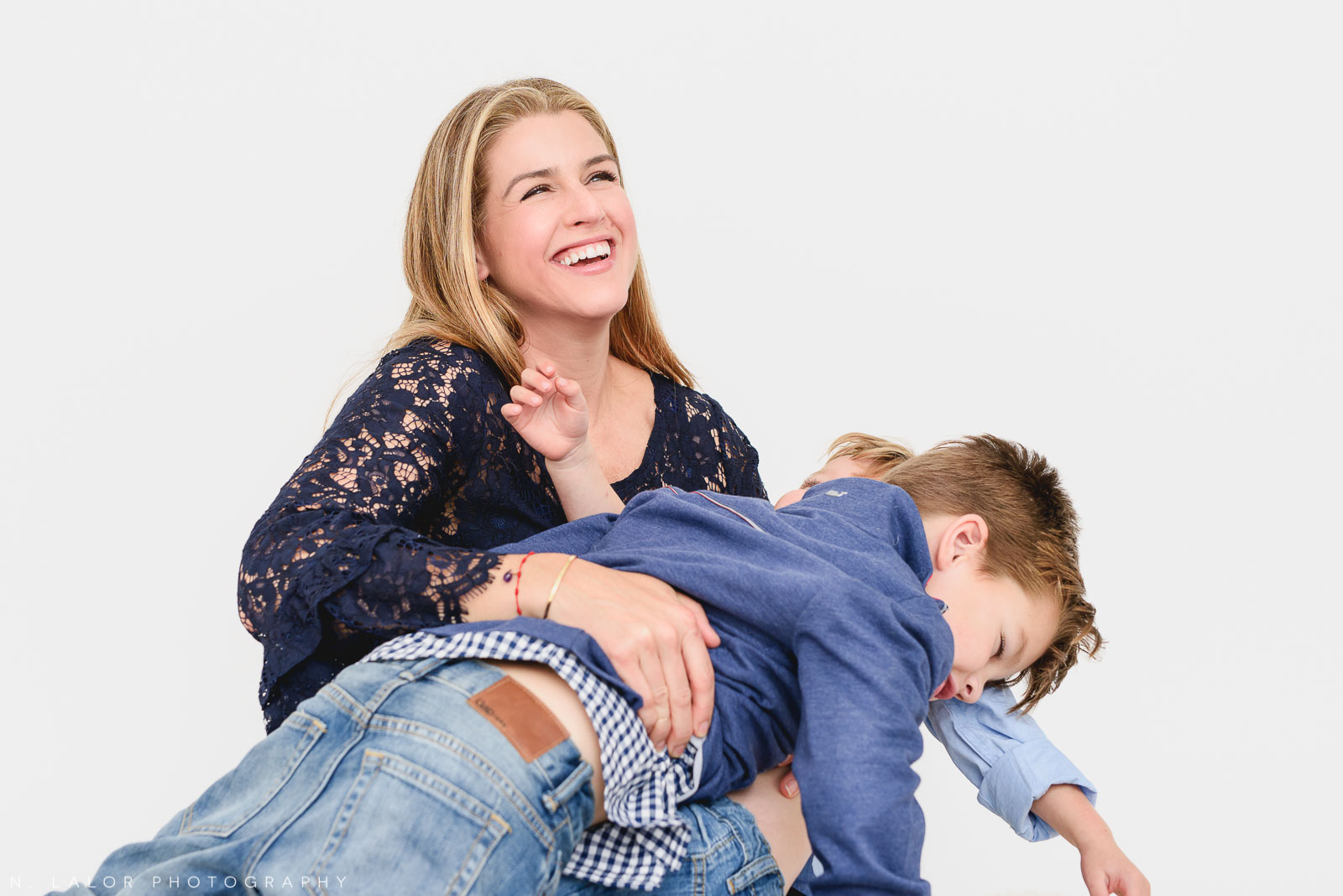 Mom with two crazy boys. Studio photo session with N. Lalor Photography. Greenwich, Connecticut.