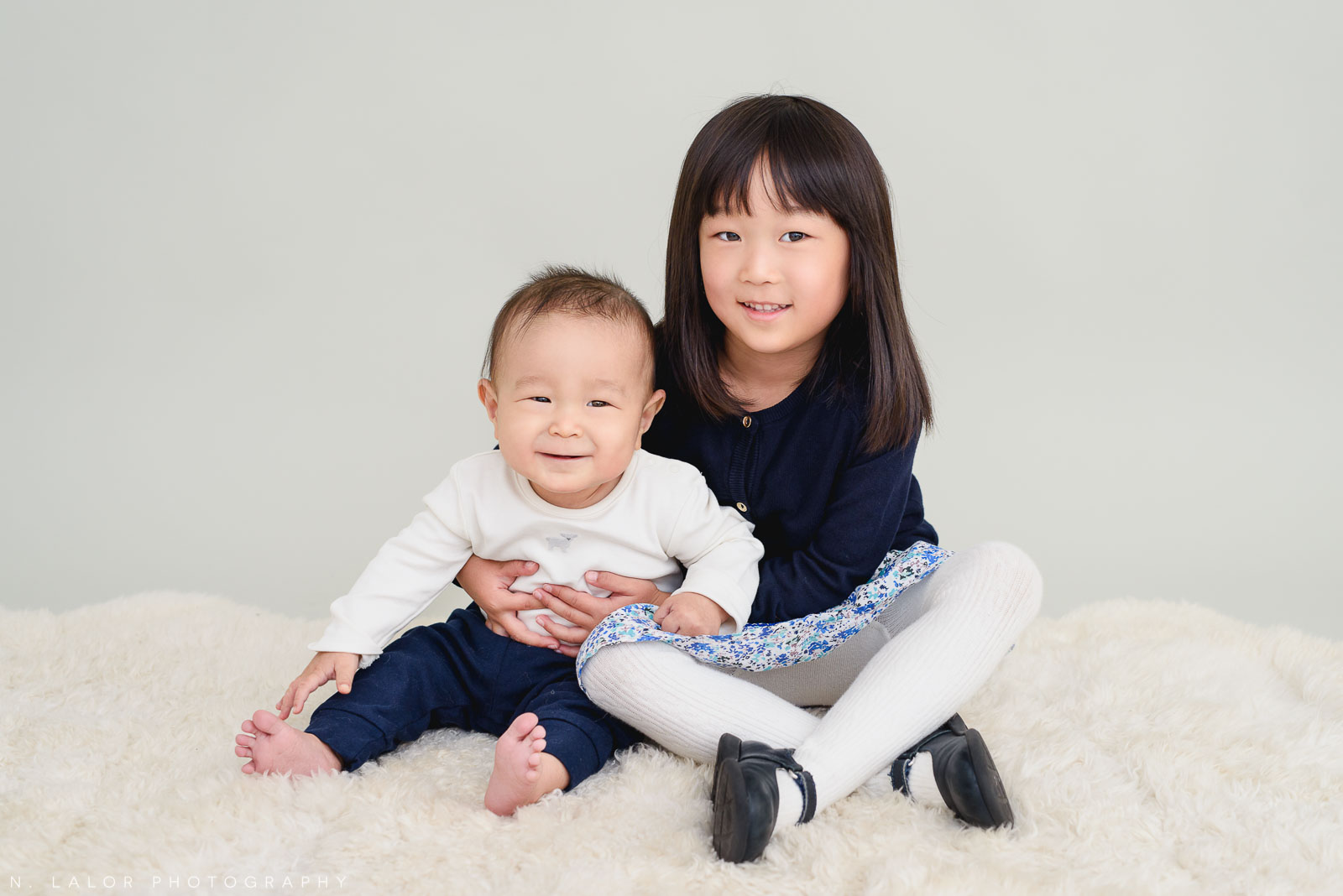 Baby brother with older sister. Greenwich CT Photo Studio family session by N. Lalor Photography.