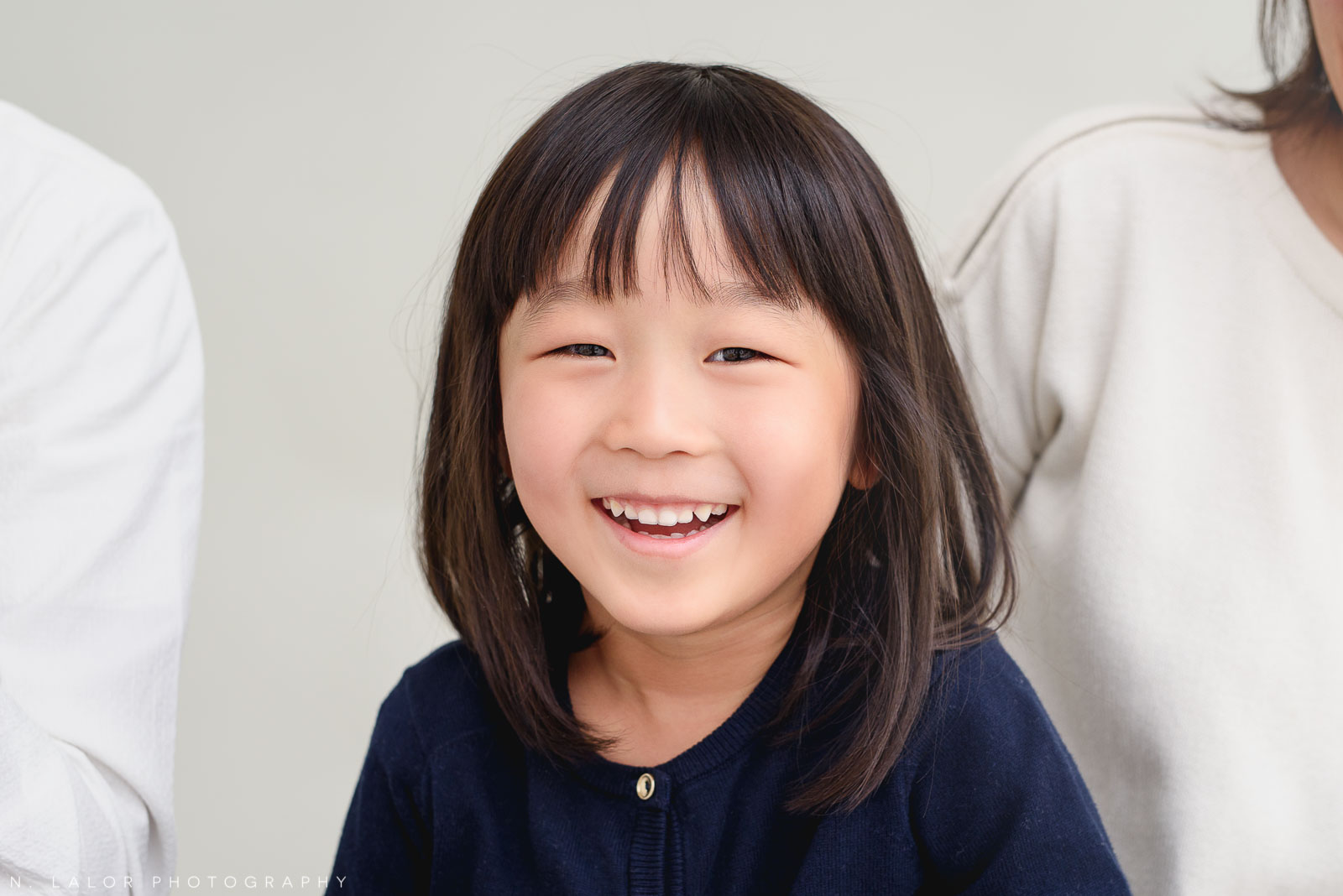5-year old smiling girl. Greenwich CT Photo Studio family session by N. Lalor Photography.