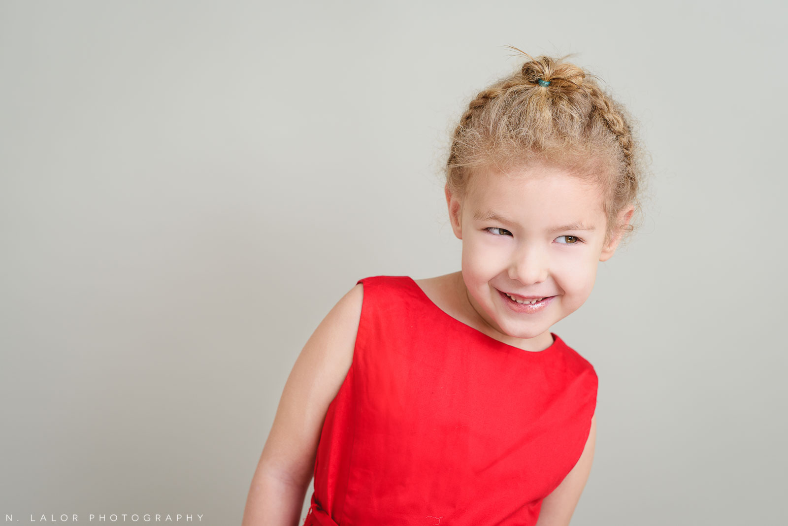 A Holiday smile. Greenwich CT Kids Photo Studio Portraits by N. Lalor Photography