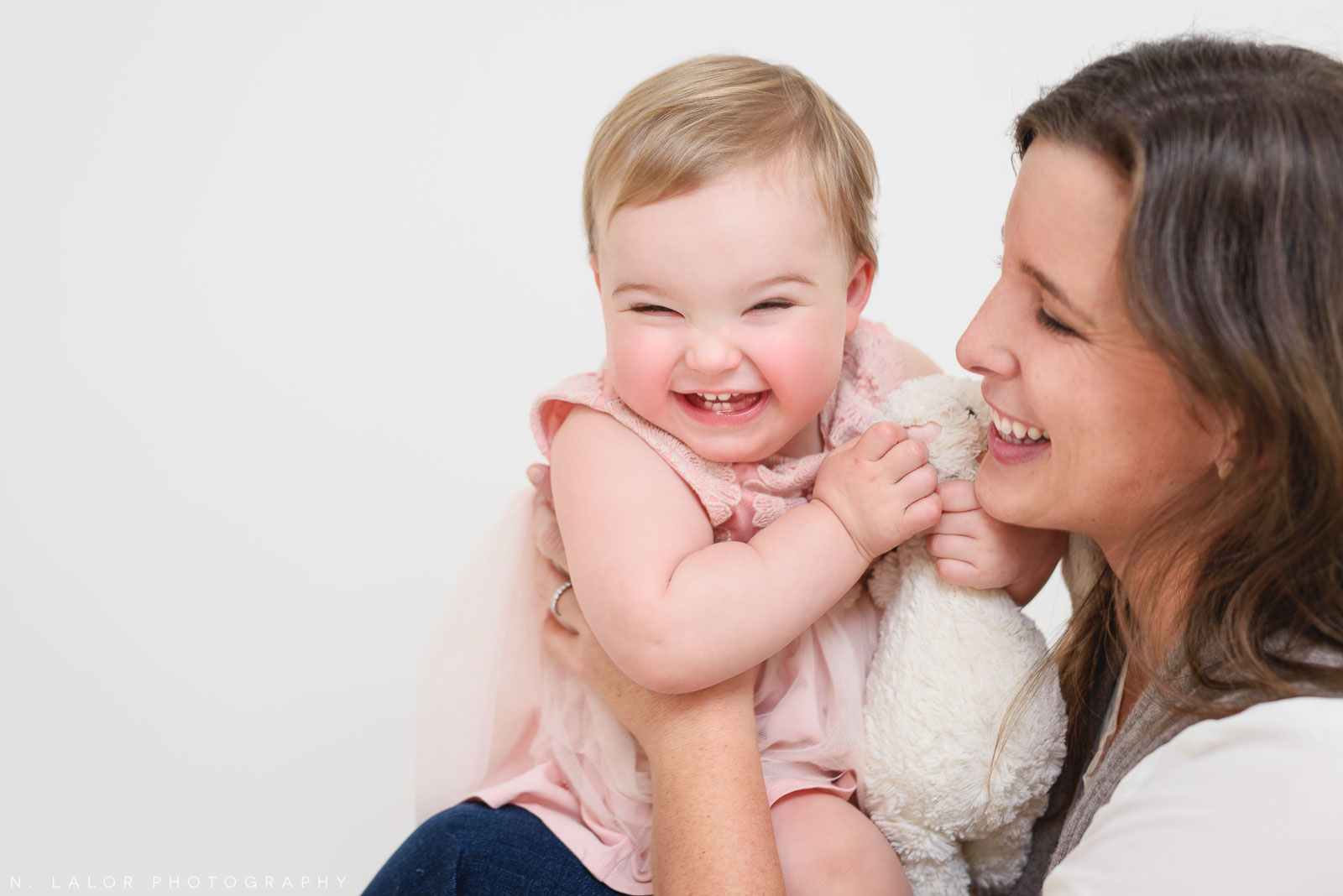 Mom laughing with daughter. Portrait by N. Lalor Photography. Greenwich, CT