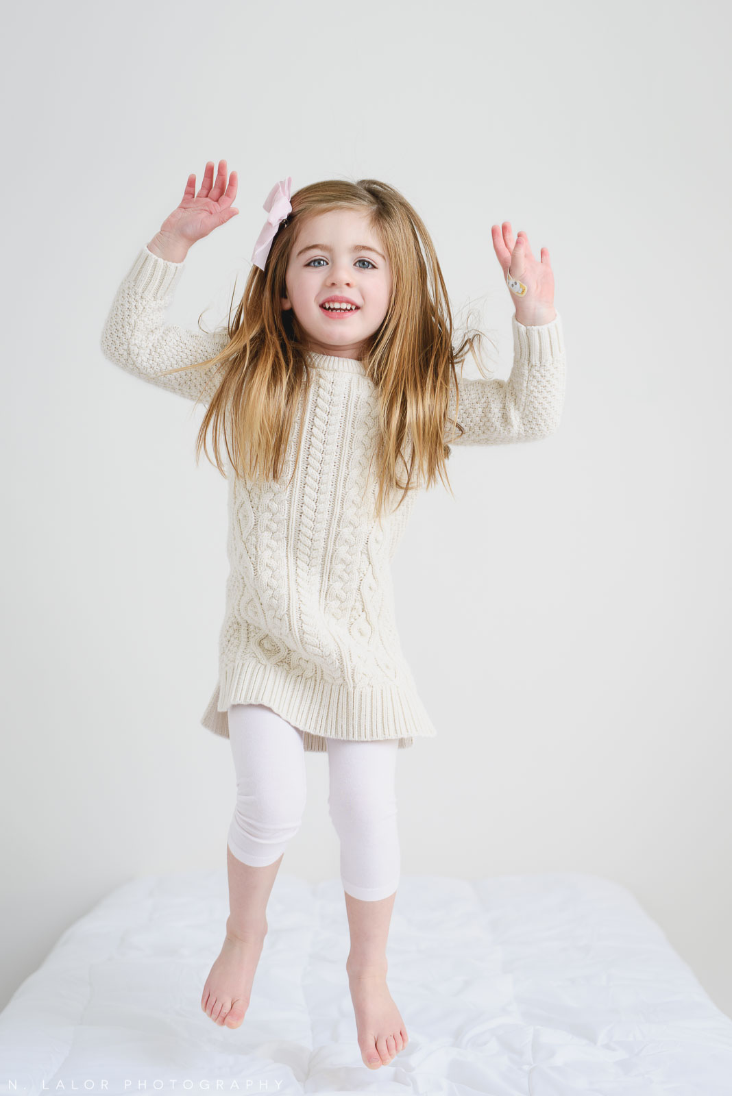Jumping around. Studio portrait by N. Lalor Photography, Greenwich CT family photographer.