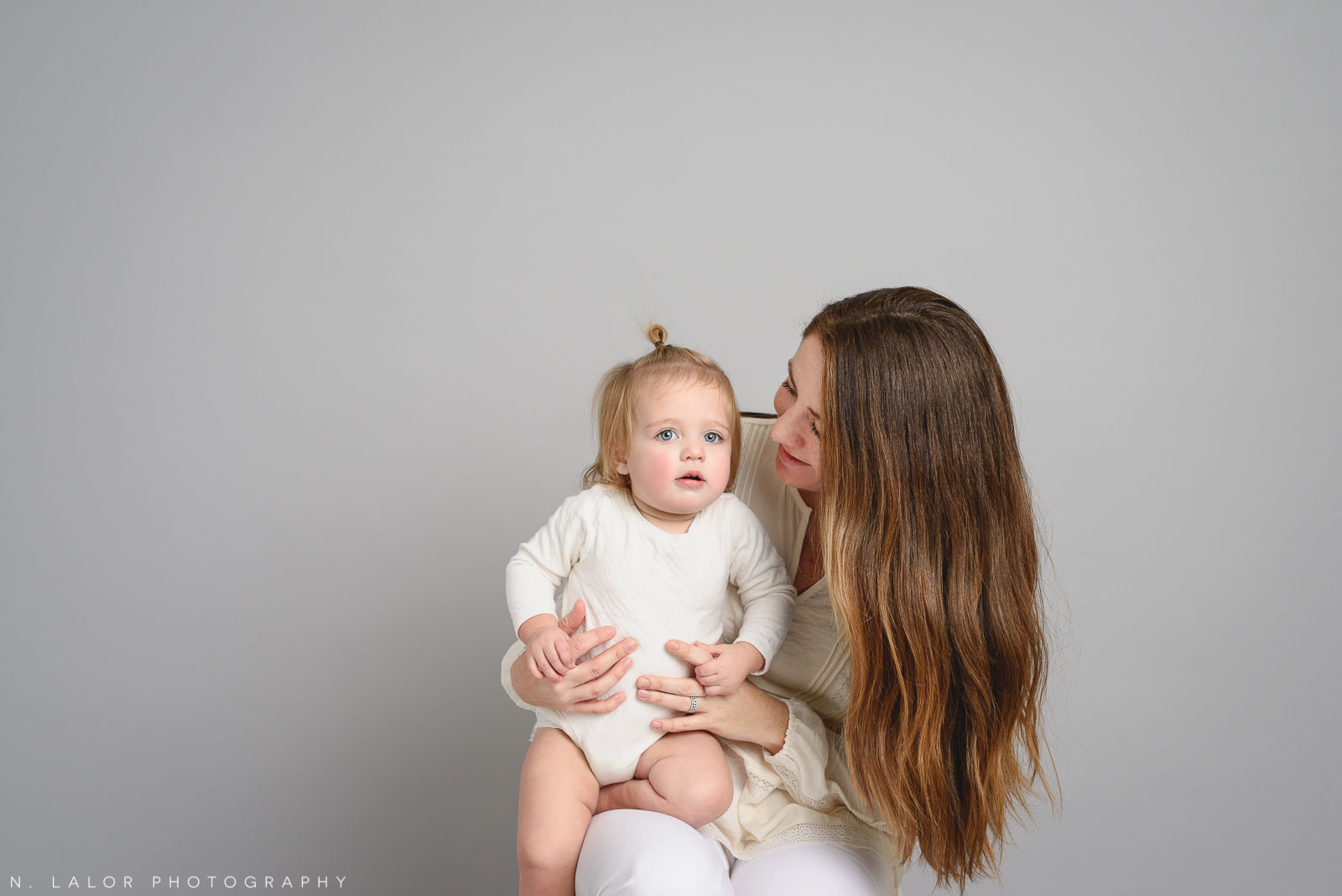 Baby girl with Mom. Studio portrait by N. Lalor Photography, Greenwich CT family photographer.