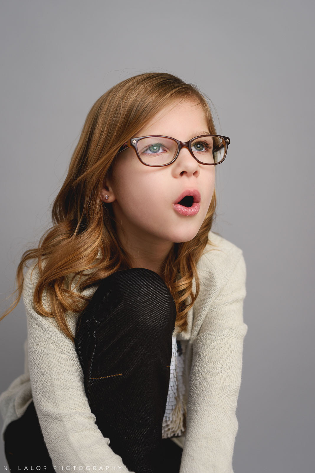 Making faces. Tween photo session with N. Lalor Photography. Studio located in Greenwich, Connecticut.