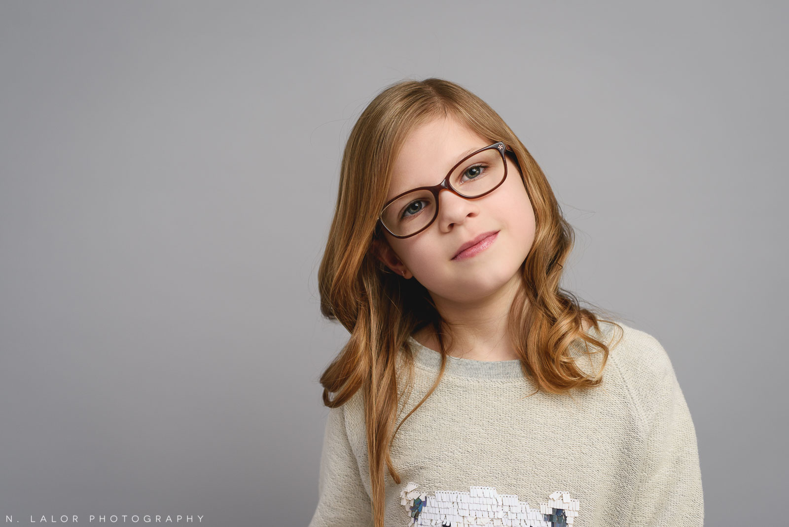 Deep in thought. Tween photo session with N. Lalor Photography. Studio located in Greenwich, Connecticut.