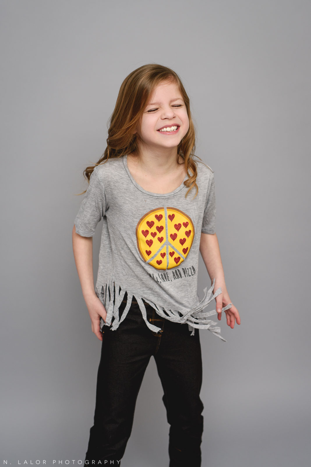 Favorite pizza shirt. Tween photo session with N. Lalor Photography. Studio located in Greenwich, Connecticut.