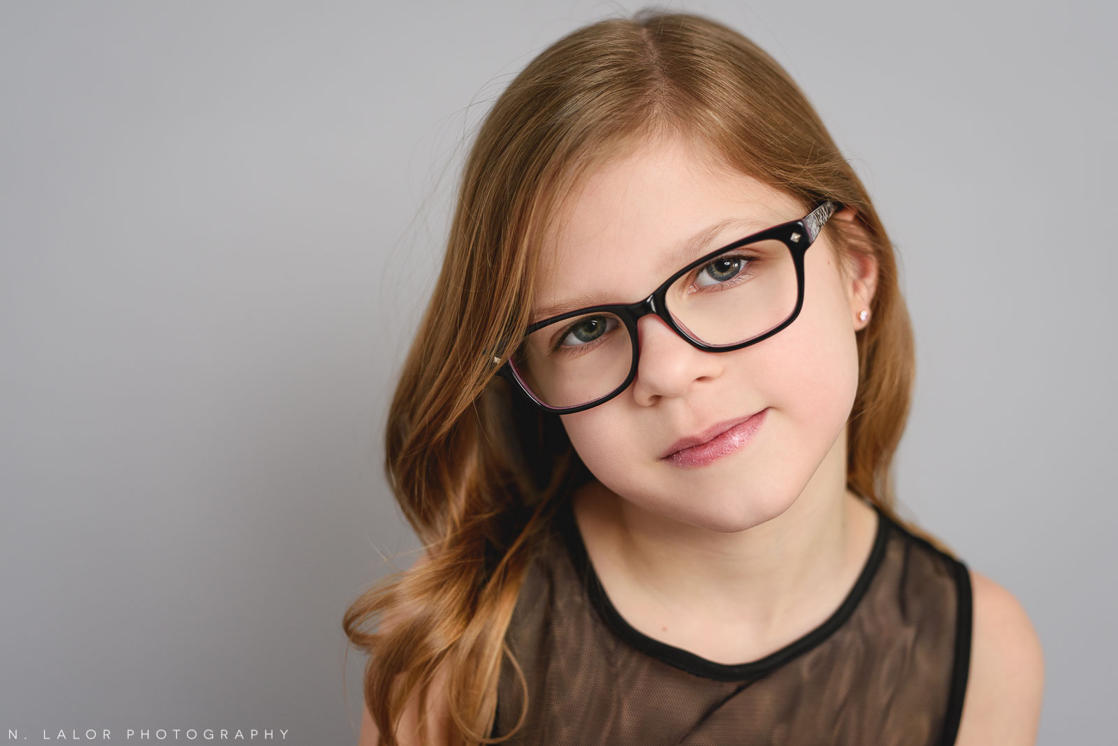 Portrait of a 9 year old girl. Tween photo session with N. Lalor Photography. Studio located in Greenwich, Connecticut.