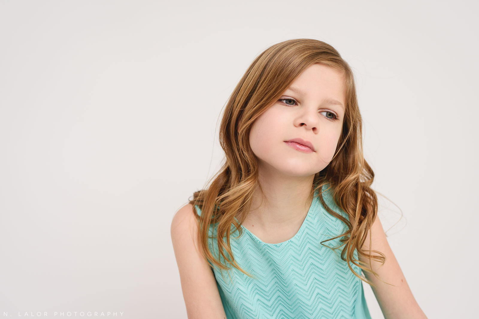 A portrait of a 9 year old girl. Tween photo session with N. Lalor Photography. Studio located in Greenwich, Connecticut.