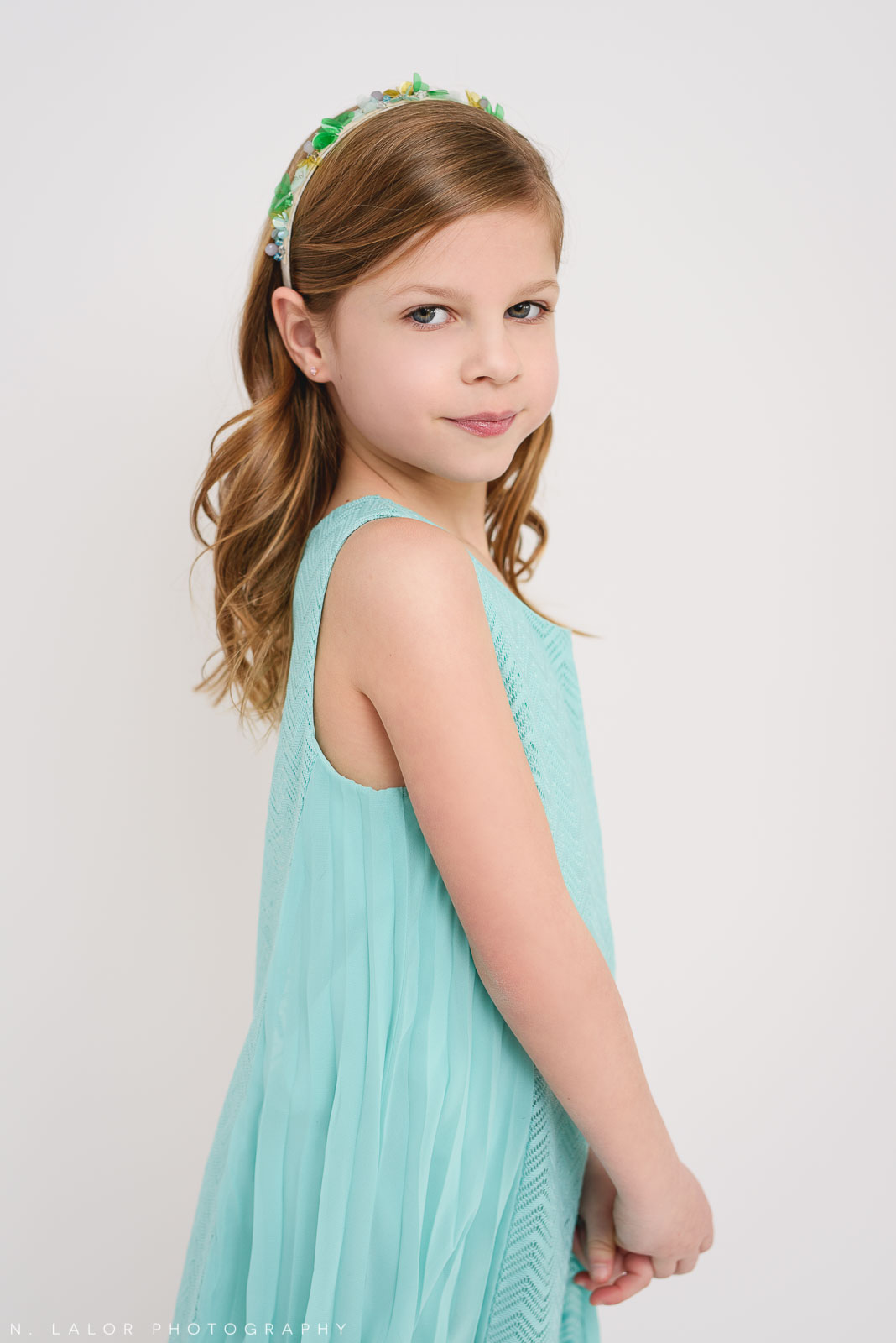 Over the shoulder. Tween photo session with N. Lalor Photography. Studio located in Greenwich, Connecticut.