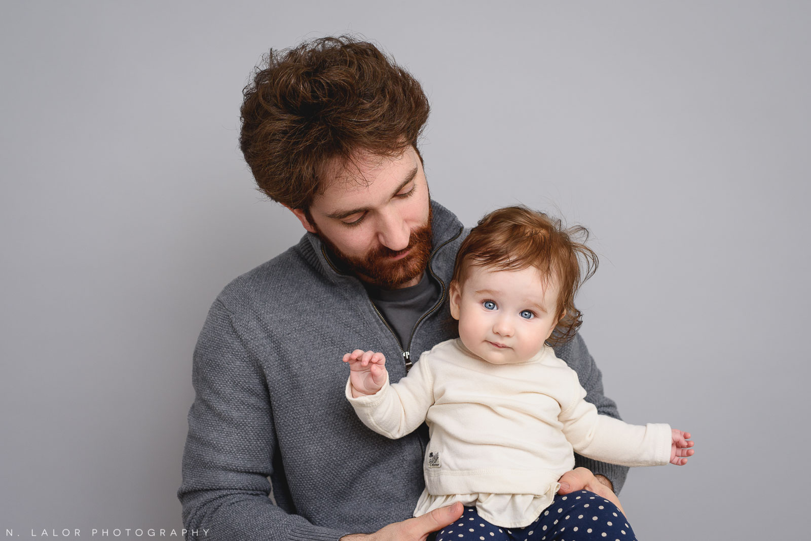 Dad with his 6-month old baby girl. Family photo session by N. Lalor Photography. Studio located in Greenwich Connecticut.