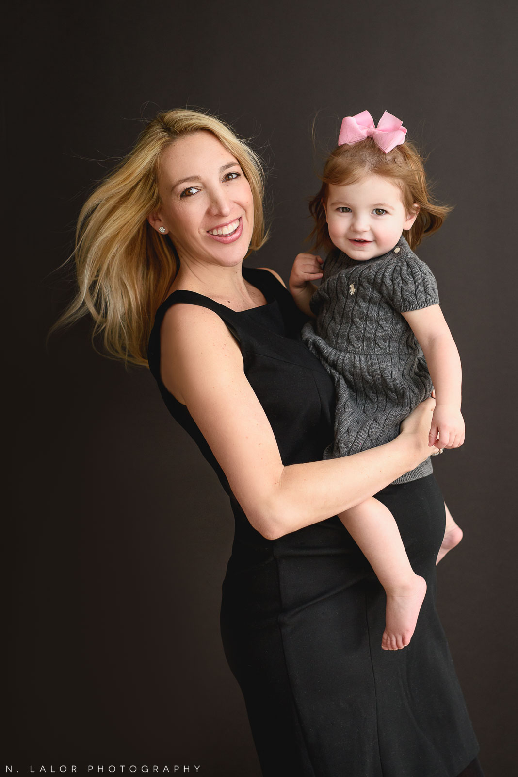 """Pregnant Mom with her oldest daughter. Maternity """"Mom and Me"""" photo session by N. Lalor Photography. Studio located in Greenwich Connecticut."""