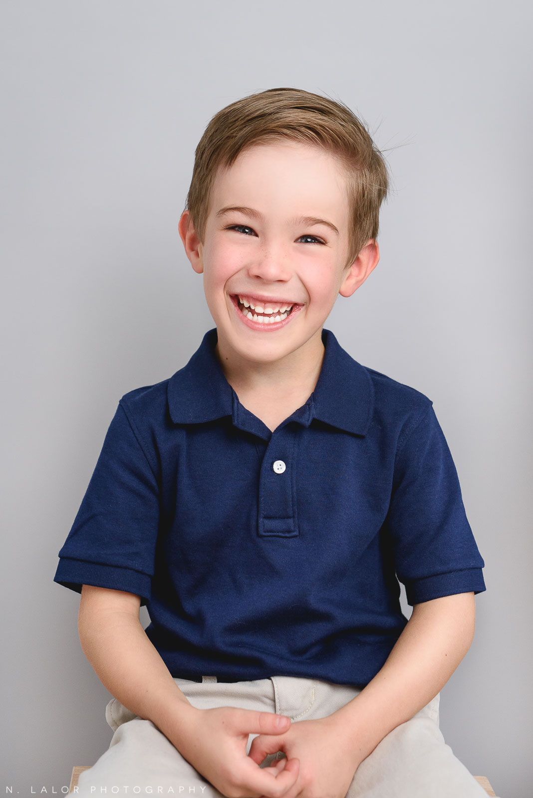 Happy boy. Studio family photoshoot with N. Lalor Photography in Riverside, Connecticut.