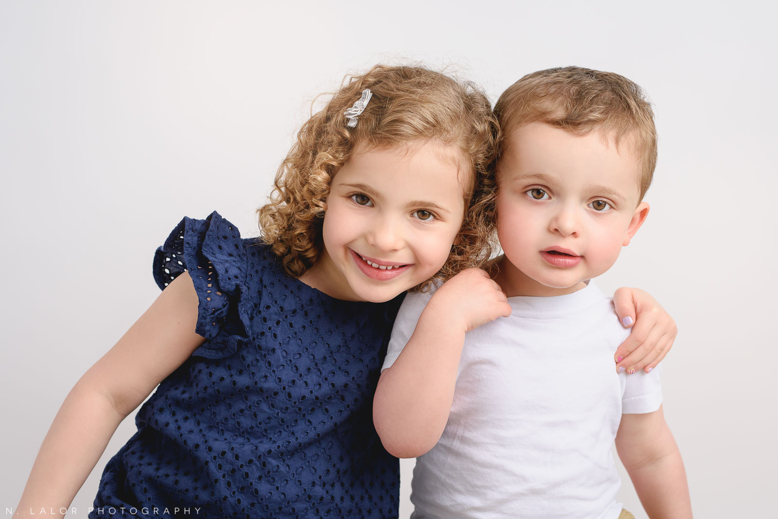 Siblings. Studio family photo session with N. Lalor Photography in Greenwich, Connecticut.