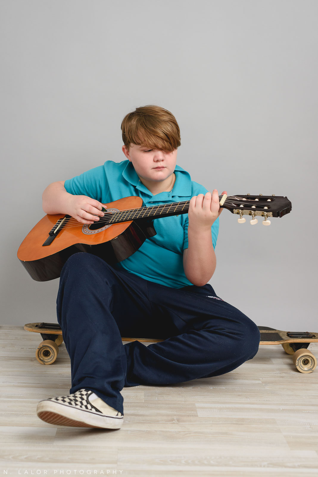 Guitars and skateboards. Teen family photo session with N. Lalor Photography. Greenwich, Connecticut studio photographer.