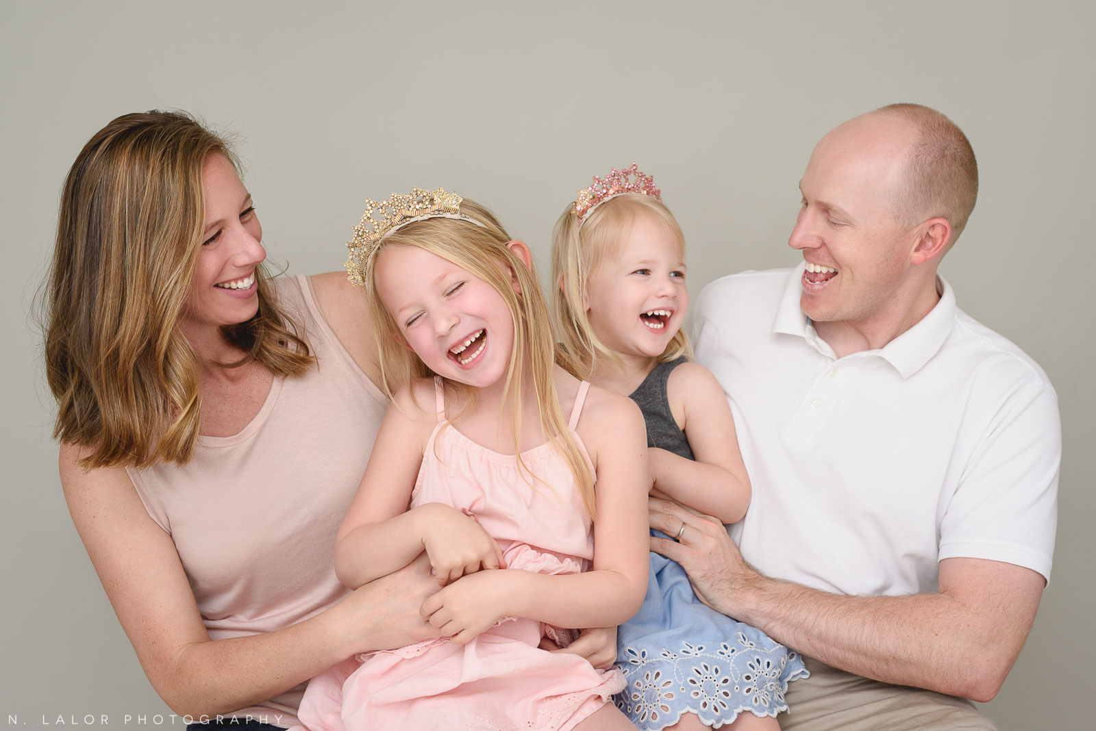 Candid family portrait. Family photo session with N. Lalor Photography. Greenwich, Connecticut studio photographer.