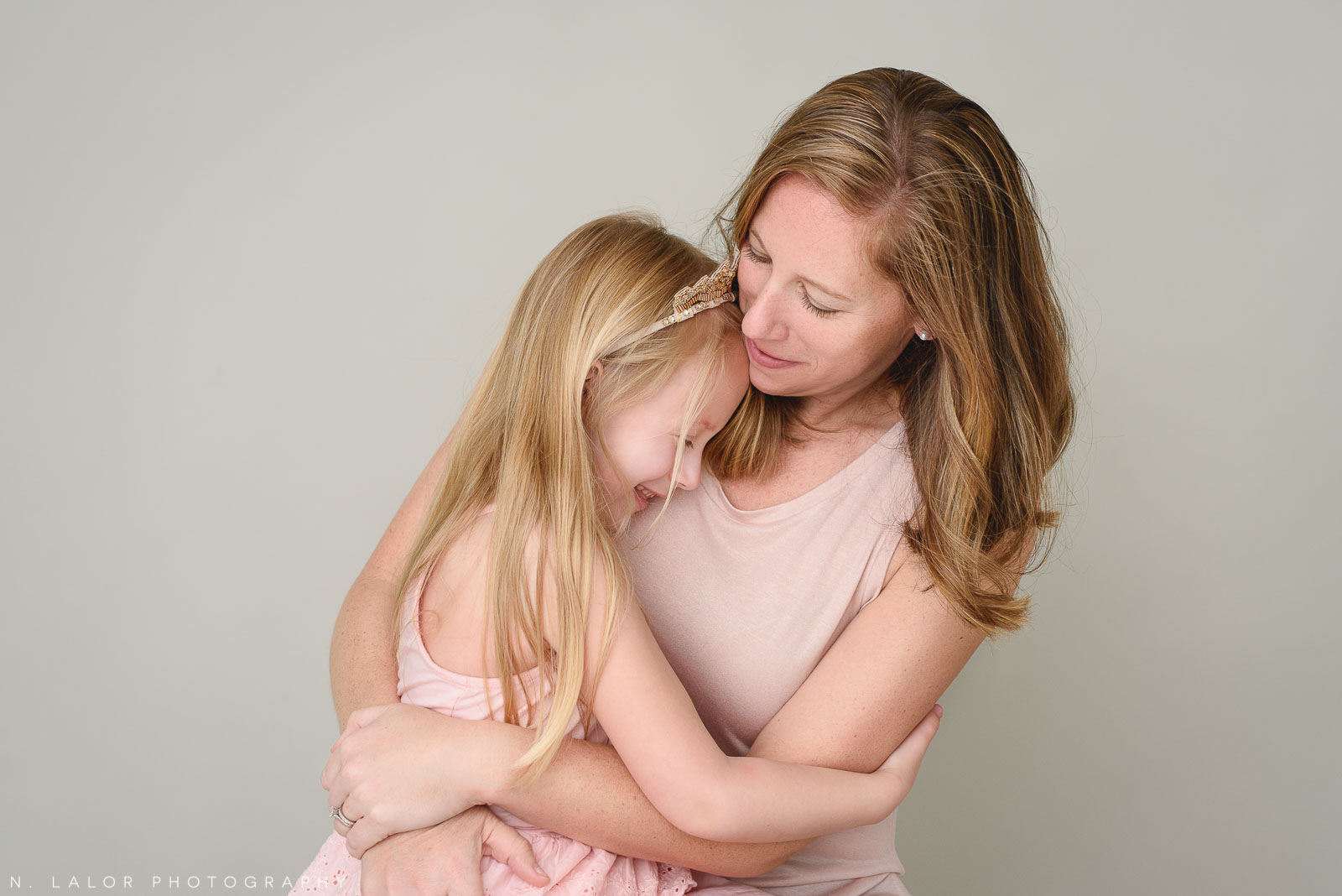 Mom and daughter. Family photo session with N. Lalor Photography. Greenwich, Connecticut studio photographer.