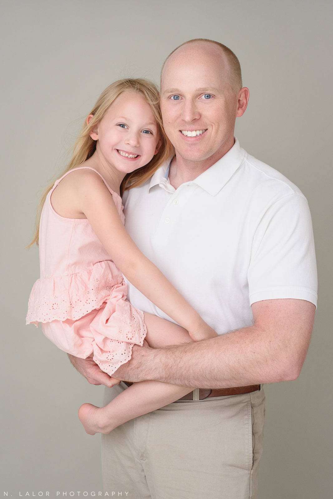 Dad with daughter. Family photo session with N. Lalor Photography. Greenwich, Connecticut studio photographer.