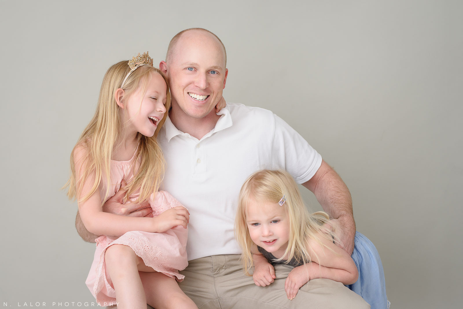 Dad with his daughters. Family photo session with N. Lalor Photography. Greenwich, Connecticut studio photographer.