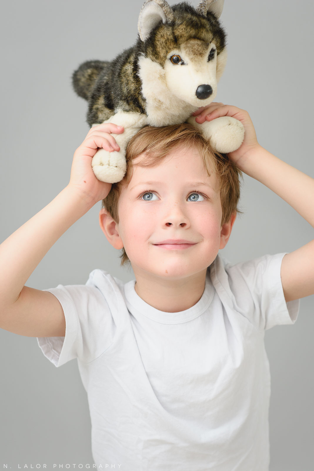 A boy and his favorite toy. Simple studio portrait session with N. Lalor Photography in Greenwich, CT.