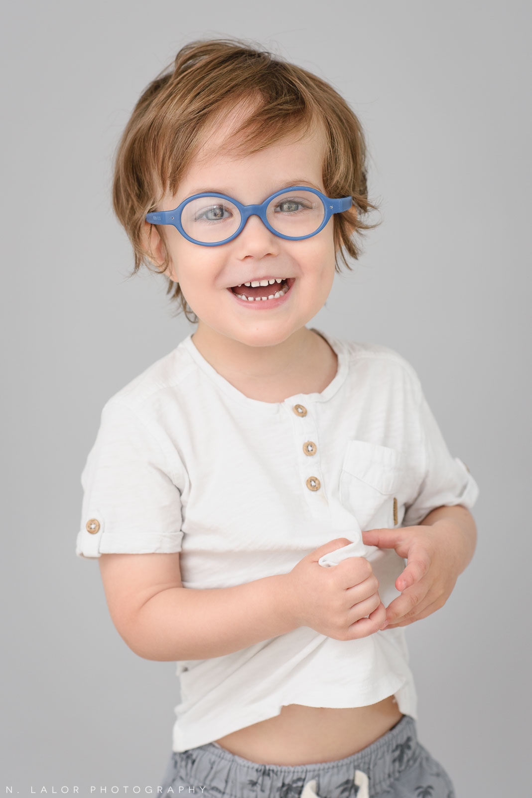 Laughing 3-yr old. Simple studio portrait session with N. Lalor Photography in Greenwich, CT.