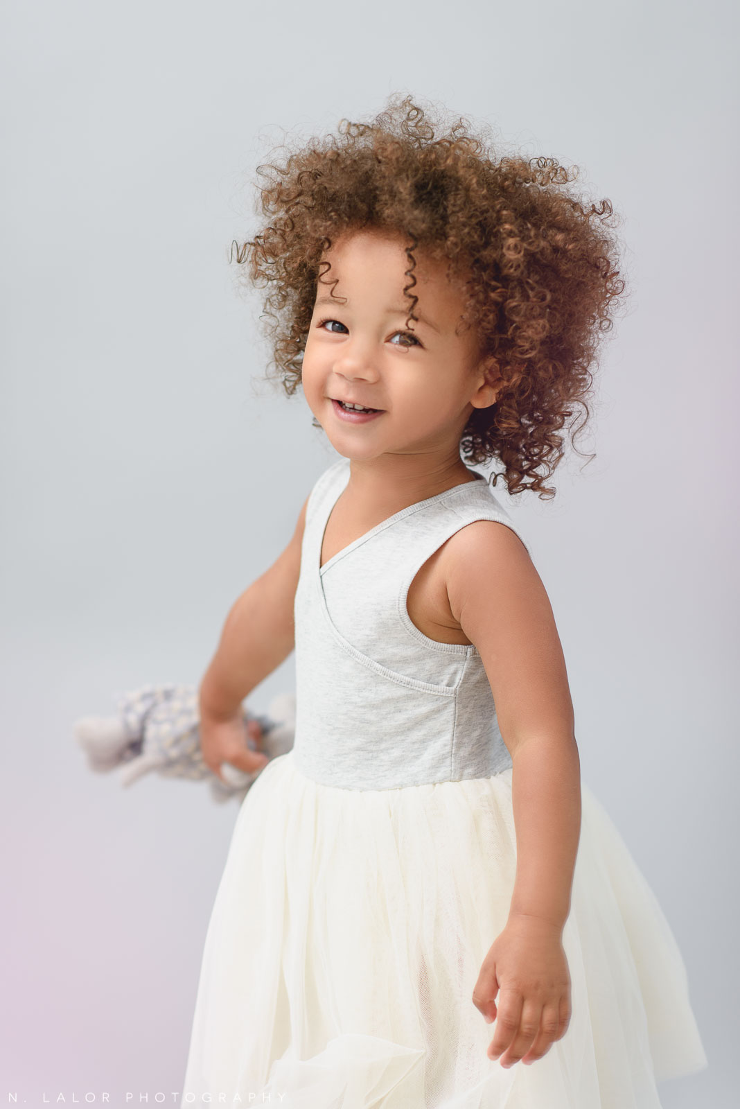 2-year old girl. Studio portrait session with N. Lalor Photography in Greenwich, Connecticut.