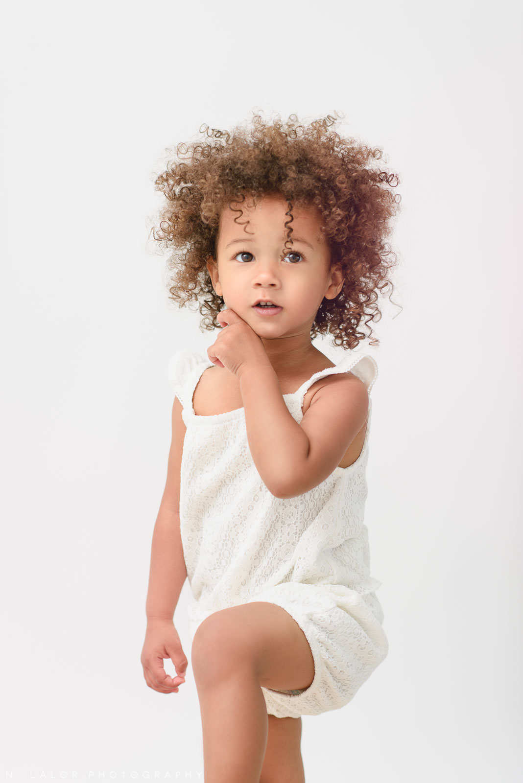 Little model. Studio portrait session with N. Lalor Photography in Greenwich, Connecticut.