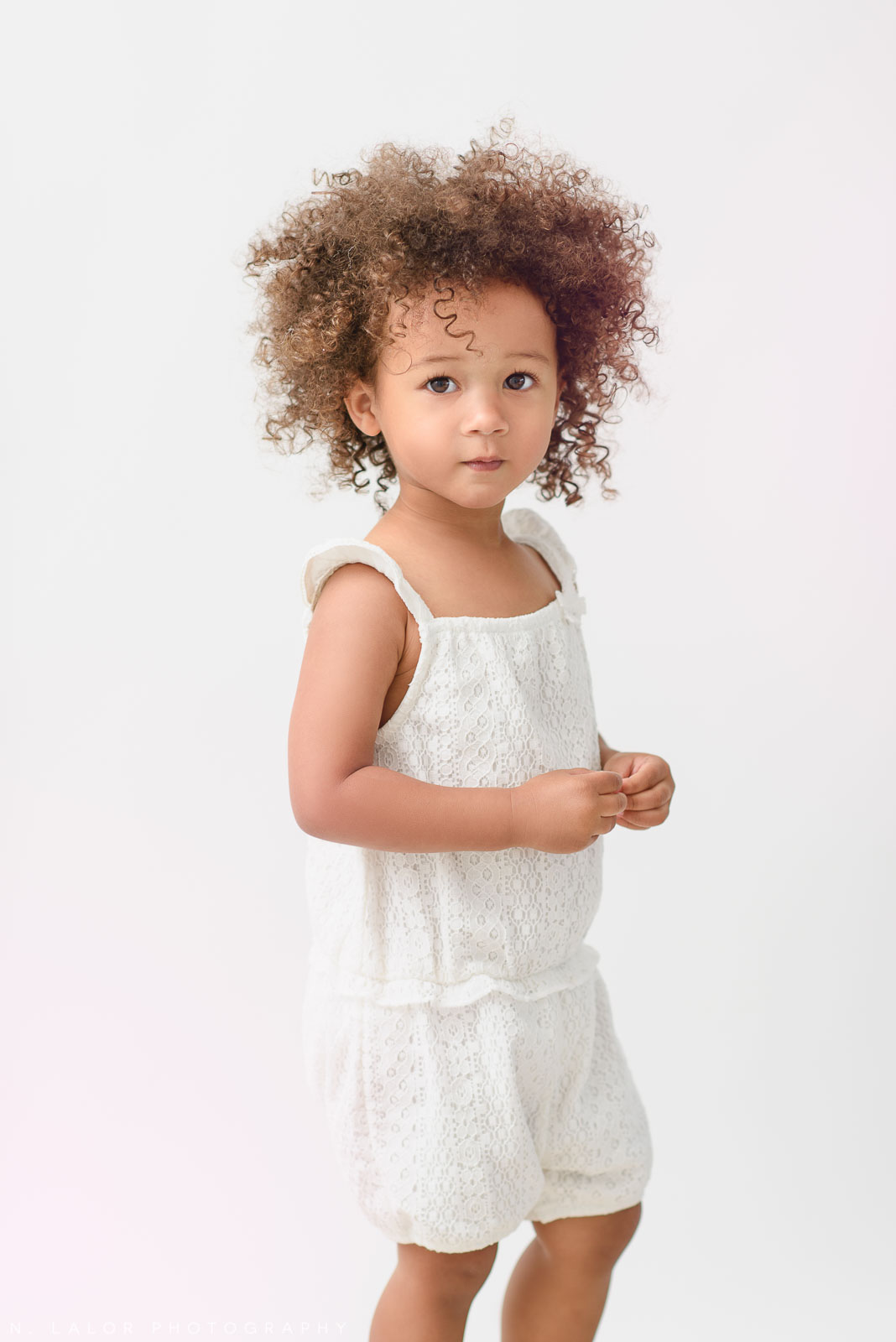 Little 2-year old model. Studio portrait session with N. Lalor Photography in Greenwich, Connecticut.