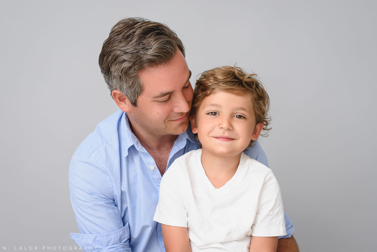 Dad with son. Family photo session by N. Lalor Photography in Greenwich, CT.