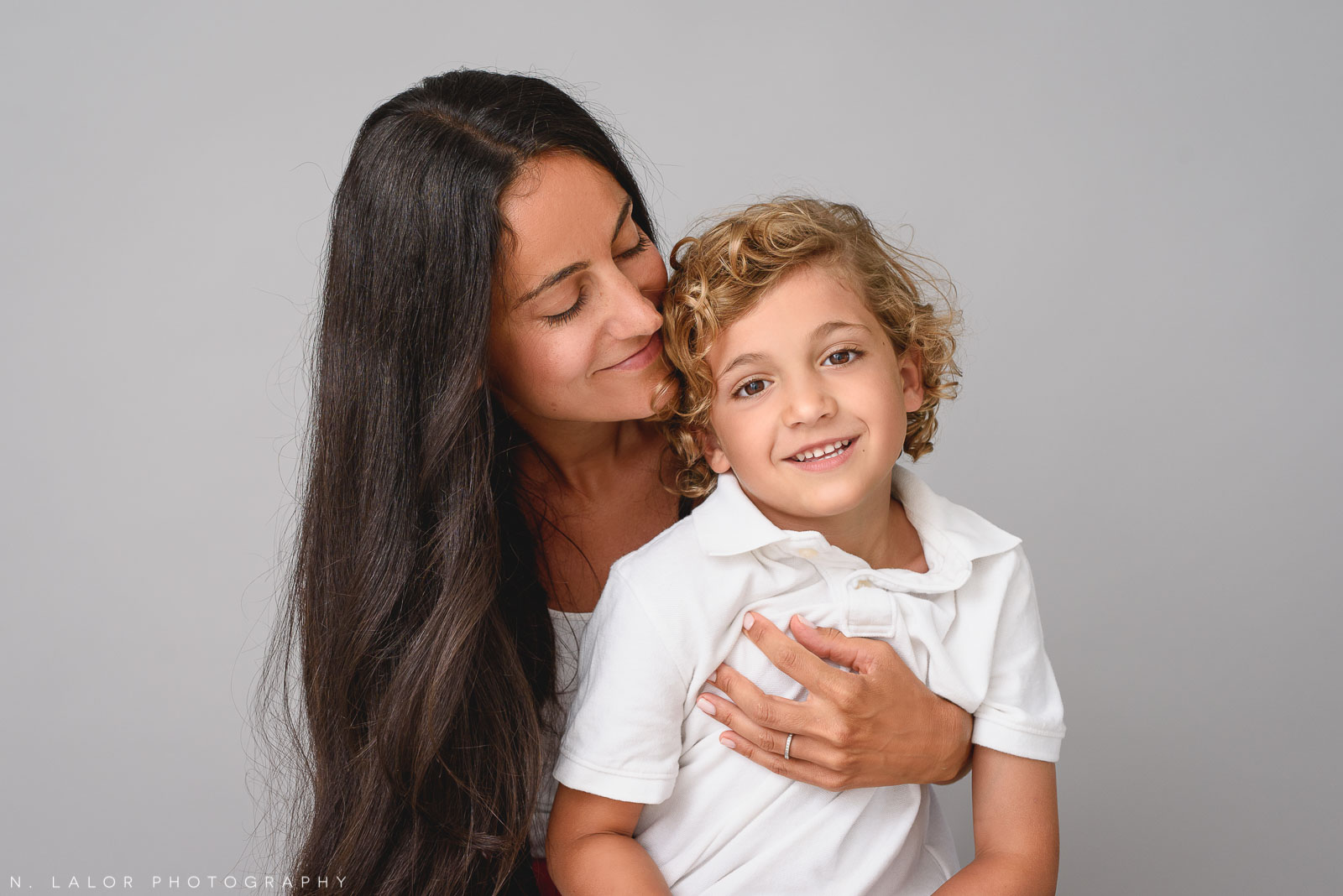 Mother and son. Family photo session by N. Lalor Photography in Greenwich, CT.