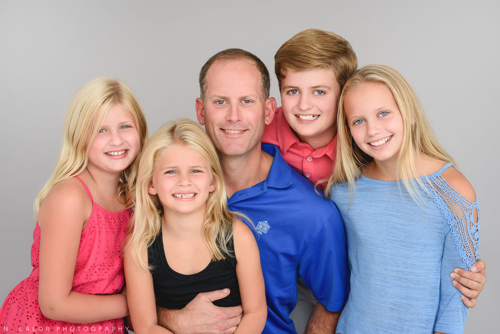 Dad with the kids. Studio family photo session with N. Lalor Photography in Greenwich, Connecticut.