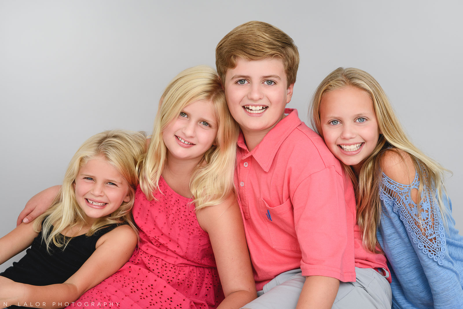 Four kids together. Studio family photo session with N. Lalor Photography in Greenwich, Connecticut.