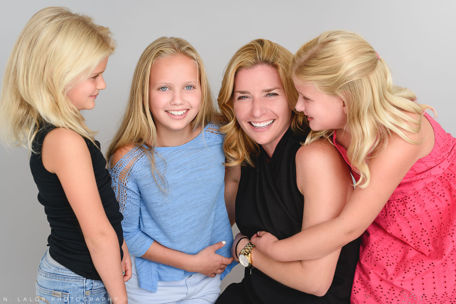 Mom with the girls. Studio family photo session with N. Lalor Photography in Greenwich, Connecticut.