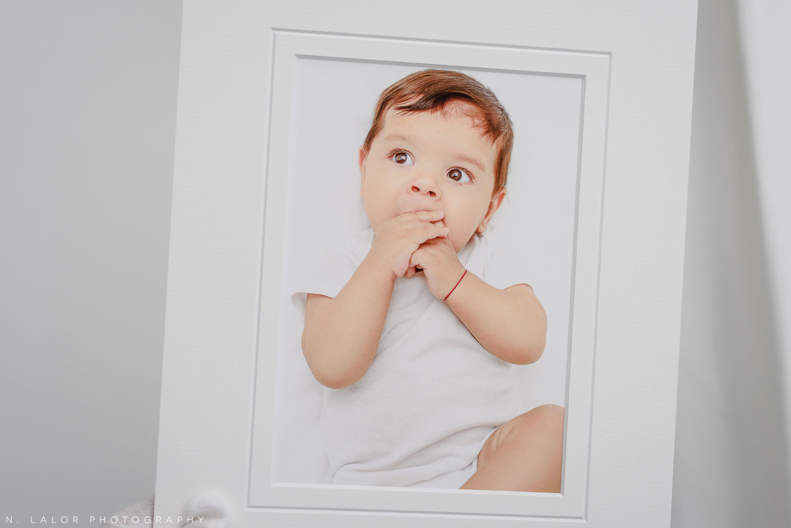 Matted fine art print. Studio baby photo session with N. Lalor Photography. Greenwich, Connecticut.