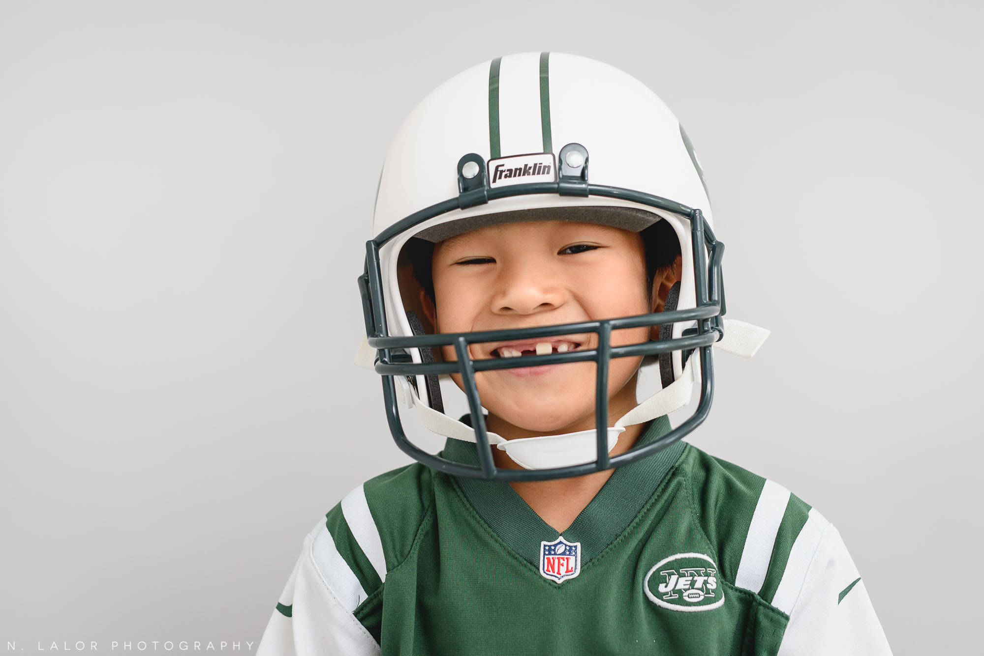 Football player. Halloween Kids Portrait by N. Lalor Photography. Greenwich, Connecticut.