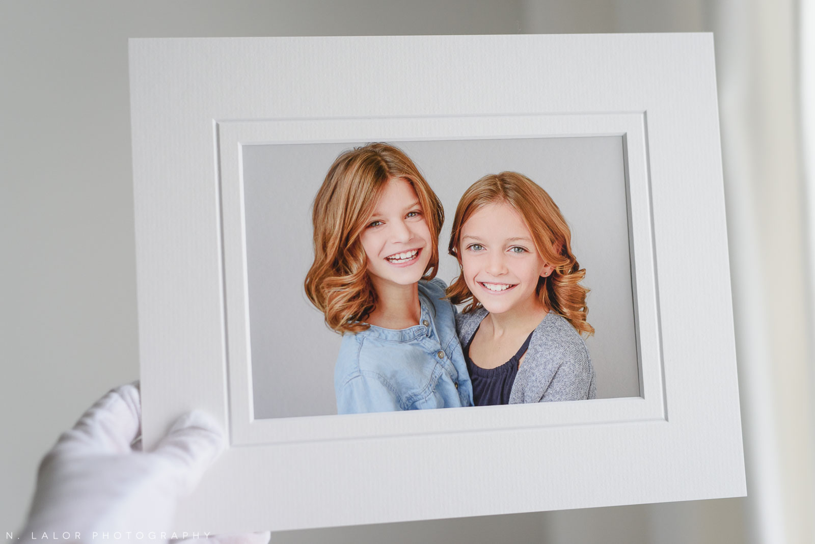 Sisters. Portrait by N. Lalor Photography in Greenwich, Connecticut.