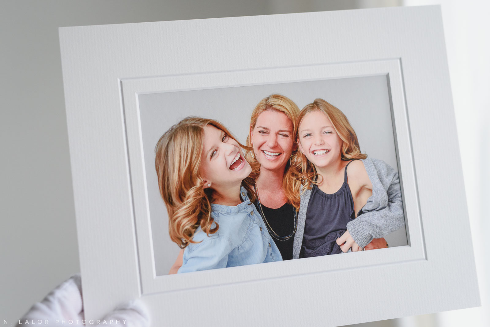 Mom with her two girls. Portrait by N. Lalor Photography in Greenwich, Connecticut.