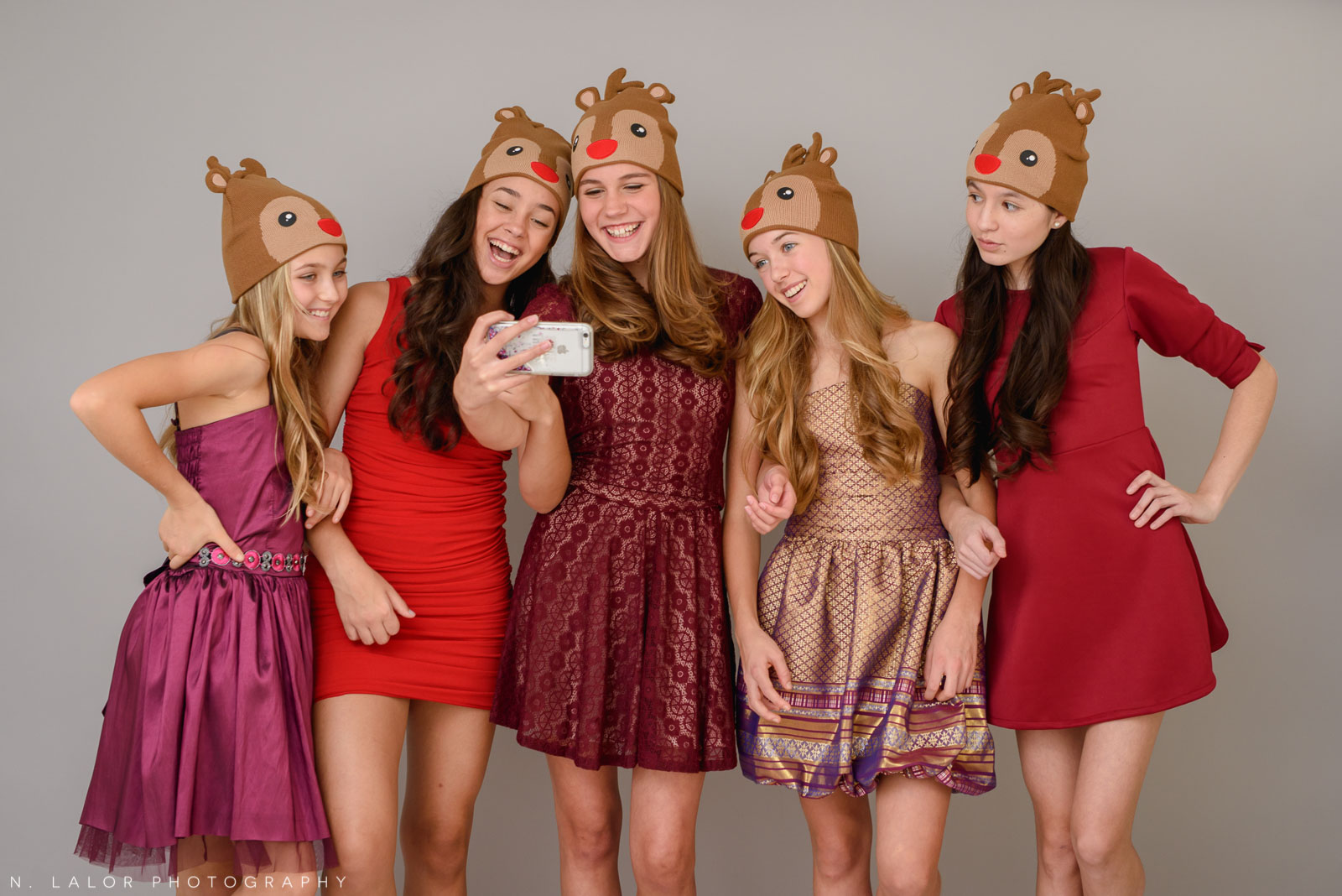 Girls taking a selfie in their holiday dresses. Photoshoot for Stella M'Lia by N. Lalor Photography in Greenwich, Connecticut.