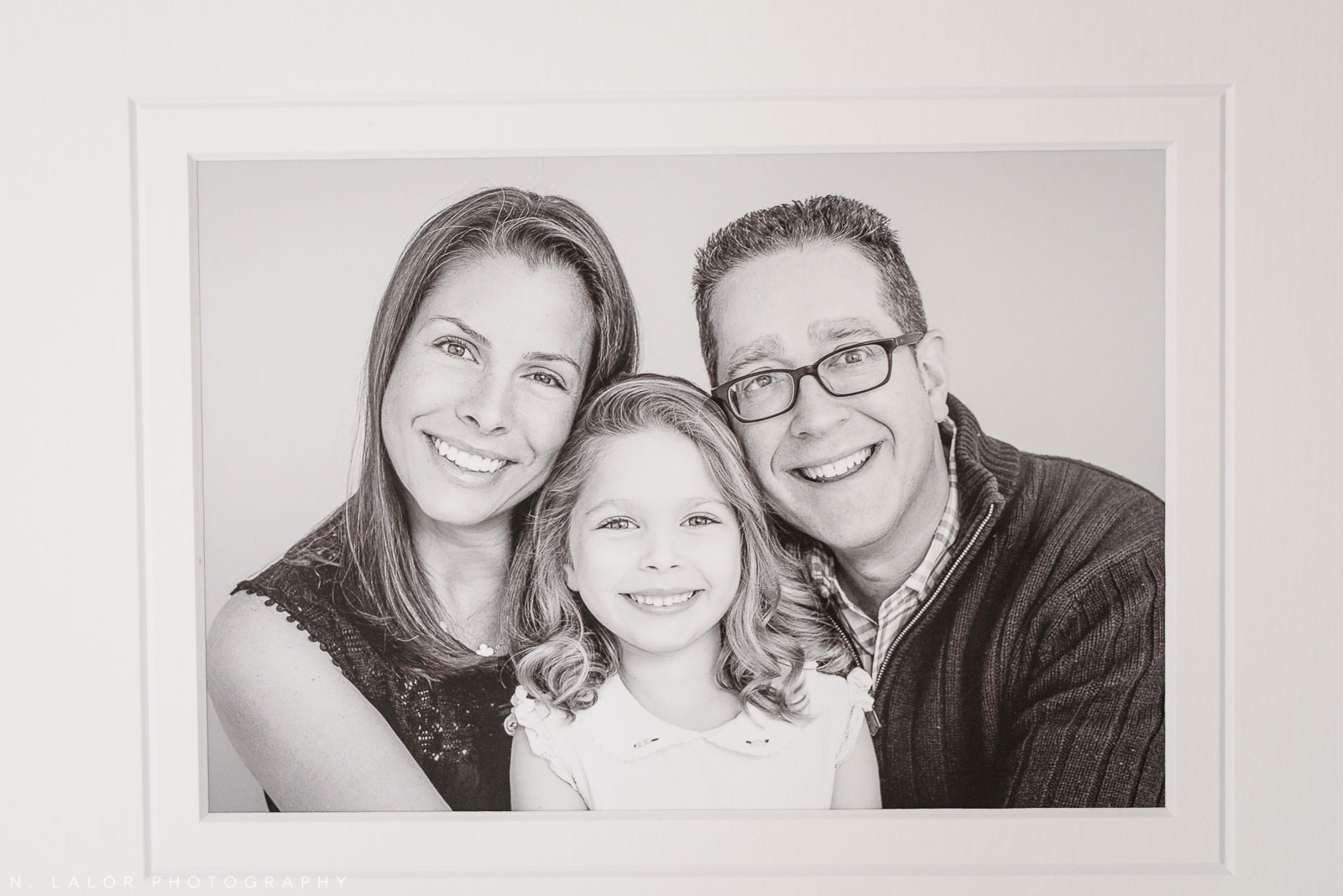Mom and Dad with daughter - fine art print. Family photoshoot by N. Lalor Photography in Greenwich, Connecticut.