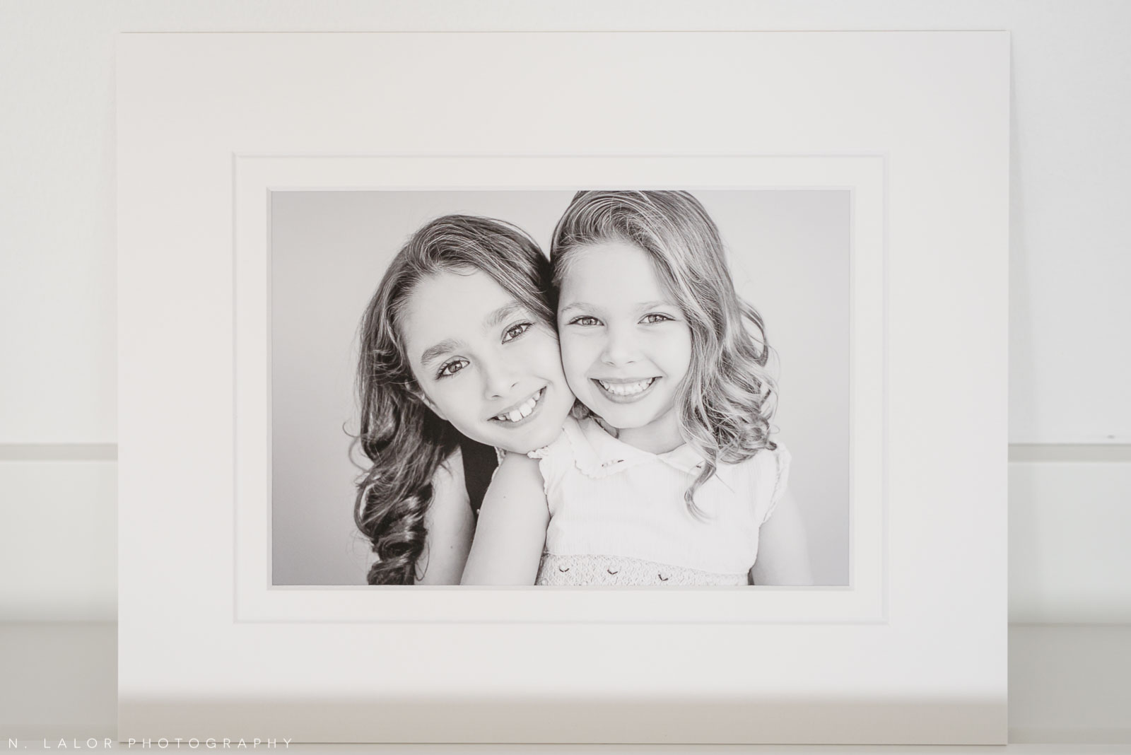 Sisters. Family photoshoot by N. Lalor Photography in Greenwich, Connecticut.