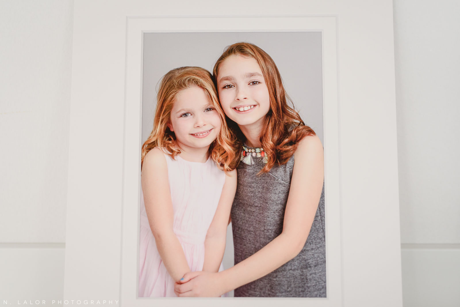 Two sisters. Fine art print. Family photoshoot by N. Lalor Photography in Greenwich, Connecticut.