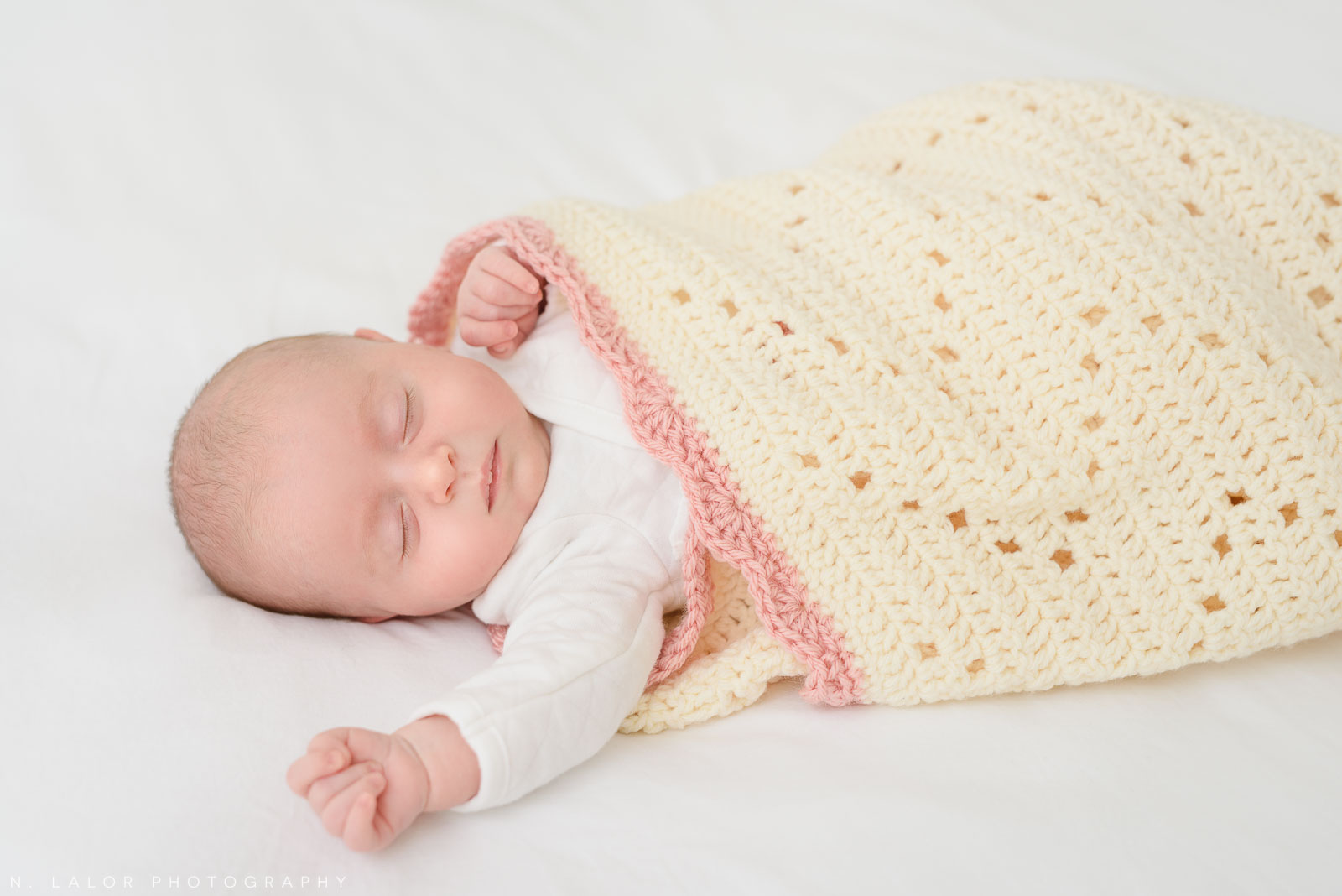 Photograph of a newborn baby girl by N. Lalor Photography. Greenwich Connecticut photo Studio.